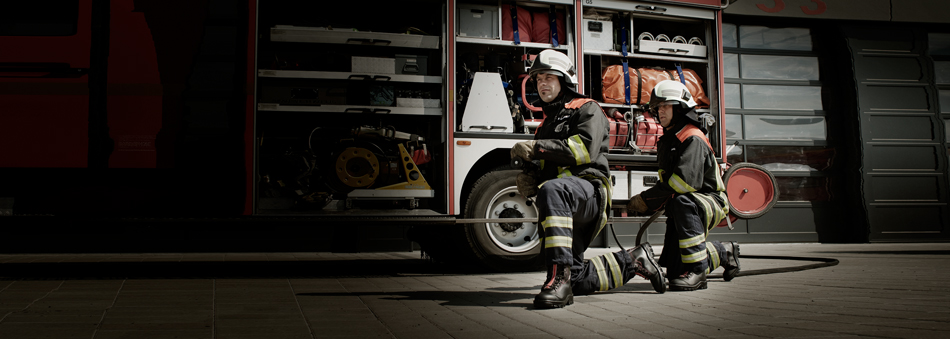 Voelkl Firefighting boots in action with 2 firemen of the Dresden fire department.